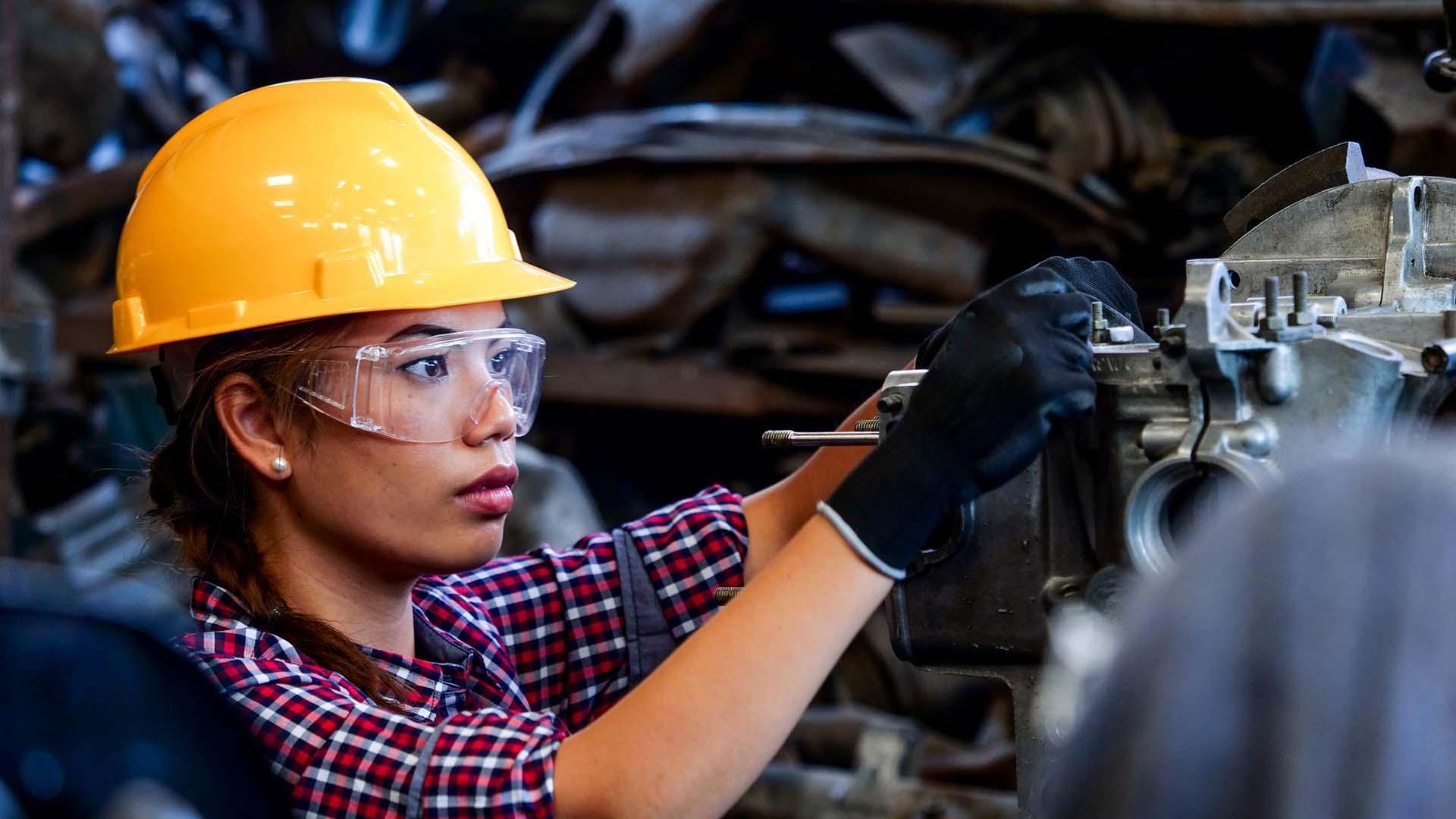 Female mechanic working on a vehicle